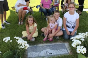 The kids at Great-Grandpa Couch's grave